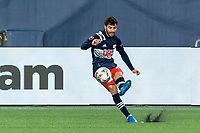 FOXBOROUGH, MA - APRIL 24: Carles Gil #22 of New England Revolution direct kick during a game between D.C. United and New England Revolution at Gillette Stadium on April 24, 2021 in Foxborough, Massachusetts.
