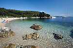 Greece, Corfu, near Agni: View along secluded beach on North East coast of island