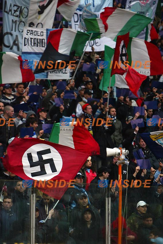 Roma 10/4/2005 Campionato Italiano Serie A <br /> Lazio Livorno 3-1 Nazist and fascist flag in SS Lazio stands Bandiera naziste e fasciste sventolano insieme a bandiere tricolori nella curva dei tifosi laziali <br /> Photo Andrea Staccioli Insidefoto