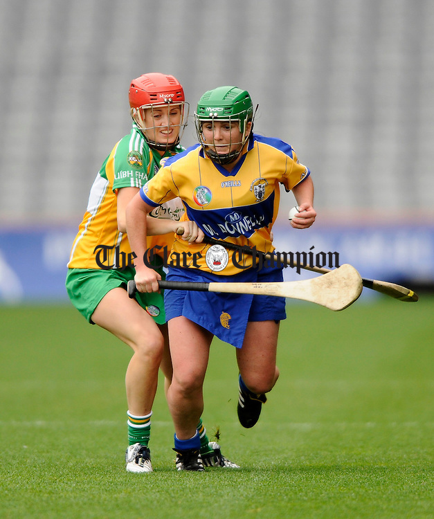 Clare's Claire Mc Mahon is tackled by Offaly's Karen Brady during the All-Ireland junior camogie final at Croke Park. Photograph by John Kelly.