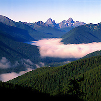 Manning Provincial Park, Southwestern BC, British Columbia, Canada - Thick Cloud Bank in Valley of Coniferous Forest in North Cascade Mountains, Aerial View