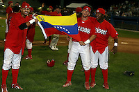 September 15 2008:  Frederick Parejo, Jose Garcia and Ismael Cardona of the Batavia Muckdogs, Class-A affiliate of the St. Louis Cardinals, celebrate winning the NY-Penn League championship after a game at Dwyer Stadium in Batavia, NY.  Photo by:  Mike Janes/Four Seam Images