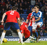 James Tavernier taken out by Fraser Kerr for a penalty kick