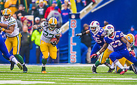 14 December 2014: Green Bay Packers running back Eddie Lacy rushes for a 12-yard gain on the opening drive against the Buffalo Bills at Ralph Wilson Stadium in Orchard Park, NY. The Bills defeated the Packers 21-13, snapping the Packers' 5-game winning streak and keeping the Bills' 2014 playoff hopes alive. Mandatory Credit: Ed Wolfstein Photo *** RAW (NEF) Image File Available ***