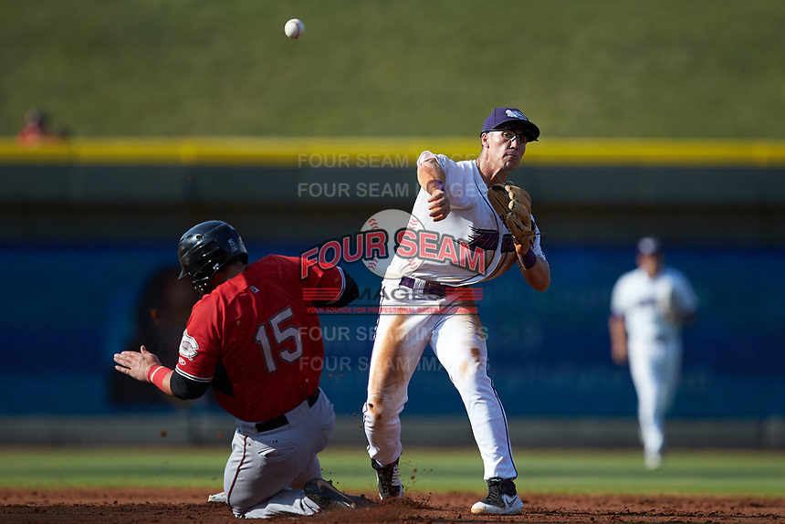 JJ Muno (10) of the Winston-Salem Dash turns a double play as Payton Henry (15) of the Carolina Mudcats slides into second base at BB&T Ballpark on June 1, 2019 in Winston-Salem, North Carolina. The Mudcats defeated the Dash 6-3 in game one of a double header. (Brian Westerholt/Four Seam Images)