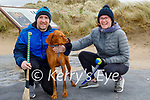 Abbie the dog being taken for a walk by Sean O'Sullivan and Leine Masale on Banna beach on Saturday.