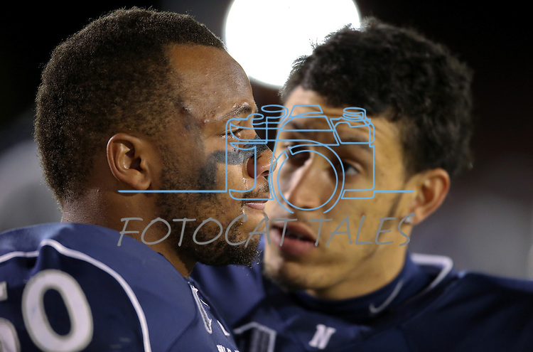 Nevada's Arthur Forrest II, right, talks to an emotional Jonathan McNeal before the start of an NCAA college football game against San Jose State, in Reno, Nev., on Saturday, Nov. 16, 2013. (AP Photo/Cathleen Allison)