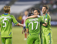 CARSON, CA - August 25, 2012: Seattle midfielder Mauro Rosales (10) congratulates Fredy Montero on his goal during the Chivas USA vs Seattle Sounders match at the Home Depot Center in Carson, California. Final score, Chivas USA 2, Seattle Sounders 6.