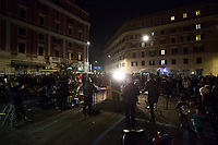 """Propaganda Orkestra (Roberto Angelini, Giovanni Di Cosimo, Fabio Rondanini, Gabriele Lazzarotti, Daniele Rossi, Daniele Tittarelli, Kyung Mi Lee, Valentina Del Re, Ramon Josè Caraballo Armas. Not all Members attended the event but sent their Solidarity).<br /> <br /> Rome, 19/12/2020. Today, the Nuovo Cinema Palazzo Community held a third public assembly (1.) in Rome's San Lorenzo district to protest against the eviction of the """"Nuovo Cinema Palazzo"""" completed by the Italian police forces in the early morning of the 25th of November and to demonstrate against the violent reaction of the Police forces when, in the evening of the same day, a large demo asked to have the chance to hold a public assembly in the square (Piazza dei Sanniti) of the cinema (2.). The public assembly of today saw the participation, performances, support & solidarity of the representatives of movements, actors, musicians, poets, students, artists, and citizens of San Lorenzo who told their stories and memories related to the famous Rome's Art and culture occupation.<br /> The Nuovo Cinema Palazzo was occupied the 15th of April 2011, when citizens, movements, workers of the entertainment industry reopened the former """"Palazzo Cinema"""" to prevent the opening of a casino/gambling space. The illegal occupation was intended as a public hub of art, culture, sport and politics, an open place for exchange, discussion, studies, caring and sharing.<br /> <br /> Footnotes & Links:<br /> 1. http://bit.do/fL2Vu<br /> 2. 25.11.2020 - Demo And Clashes Against Nuovo Cinema Palazzo Eviction in Rome's San Lorenzo: http://bit.do/fLxgz<br /> Previous Public Assemblies: http://bit.do/fLCr3 & http://bit.do/fL2VR & http://bit.do/fL2Y5<br /> Videos of the Event: http://bit.do/fL2Wc & http://bit.do/fL2V6"""