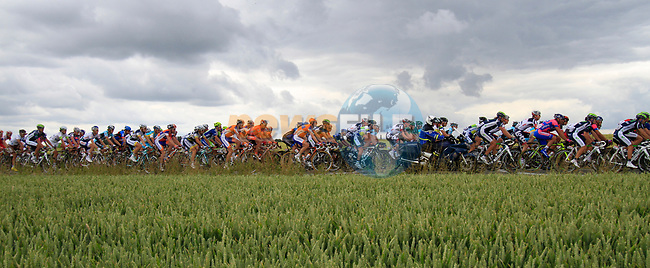 The peloton passes through farmland near the village of Aubers during Stage 3 of the 99th edition of the Tour de France 2012, running 197km from Orchies to Boulogne-sur-Mere, France. 3rd July 2012.<br /> (Photo by Eoin Clarke/NEWSFILE)