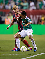 Brek Shea (17) of the USMNT fights for the ball with Giovani dos Santos (10) of Mexico during the game at Lincoln Financial Field in Philadelphia, PA. The USMNT tied Mexico, 1-1.