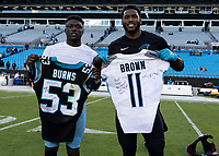CHARLOTTE, NC - NOVEMBER 3: Brian Burns #53 of the Carolina Panthers and A.J. Brown #11 of the Tennessee Titans trade jerseys after the game during a game between Tennessee Titans and Carolina Panthers at Bank of America Stadium on November 3, 2019 in Charlotte, North Carolina.