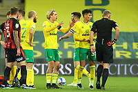 17th April 2021; Carrow Road, Norwich, Norfolk, England, English Football League Championship Football, Norwich versus Bournemouth; The referee shows Dimitris Giannoulis of Norwich City a red card after the foul on Ben Pearson of Bournemouth