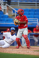 Palm Beach Cardinals catcher Jose Gonzalez (38) checks the runners after forcing out Andy Fermin sliding into home during the first game of a doubleheader against the Dunedin Blue Jays on July 31, 2015 at Florida Auto Exchange Stadium in Dunedin, Florida.  Dunedin defeated Palm Beach 7-0.  (Mike Janes/Four Seam Images)