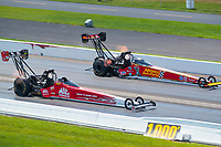 Sep 2, 2019; Clermont, IN, USA; NHRA top fuel driver Doug Kalitta (near) against Brittany Force during the US Nationals at Lucas Oil Raceway. Mandatory Credit: Mark J. Rebilas-USA TODAY Sports
