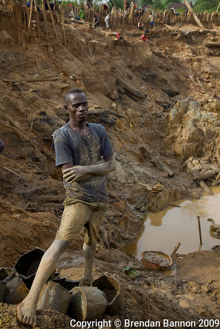 """Didudonne Dela, a miner at Nizi mine, he has worked at this site for 15 years """"This  is all that i know i can do. If i get a lot of gold then yes i will get alot of money, but it is not common to find alot of  gold in this place"""" he  said...Nizi Mine, 25 km north of Bunia, where artisianal miners have diverted the course of the river so that they can dig into what was teh river bed to search for gold. It is estimated that up to one ton of earth is moved to find just a gram of gold.."""
