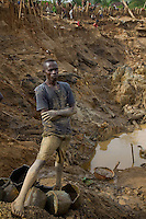 "Didudonne Dela, a miner at Nizi mine, he has worked at this site for 15 years ""This  is all that i know i can do. If i get a lot of gold then yes i will get alot of money, but it is not common to find alot of  gold in this place"" he  said...Nizi Mine, 25 km north of Bunia, where artisianal miners have diverted the course of the river so that they can dig into what was teh river bed to search for gold. It is estimated that up to one ton of earth is moved to find just a gram of gold.."