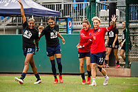 TACOMA, WA - JULY 31: OL Reign enters the pitch for warm ups before a game between Racing Louisville FC and OL Reign at Cheney Stadium on July 31, 2021 in Tacoma, Washington.