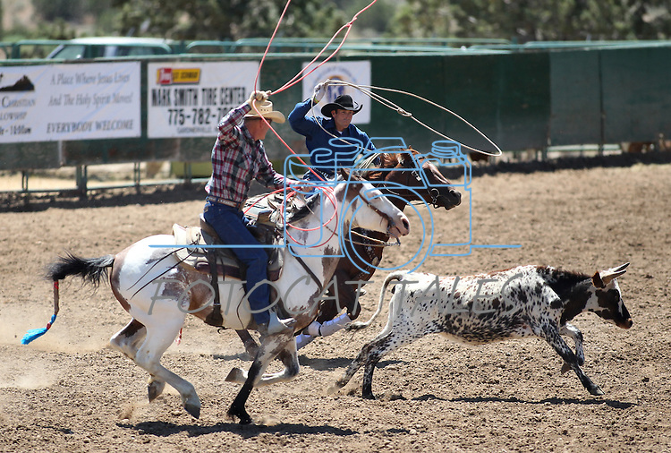 Kenny and Flint Lee compete in the team roping event at the Minden Ranch Rodeo on Saturday, July 23, 2011, in Gardnerville, Nev..Photo by Cathleen Allison