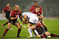 20121020 Copyright onEdition 2012©.Free for editorial use image, please credit: onEdition..Gaetan Germain of Racing Metro 92 is tackled by (L-R) Charlie Hodgson, Owen Farrell and Neil de Kock of Saracens during the Heineken Cup Round 2 match between Saracens and Racing Metro 92 at the King Baudouin Stadium, Brussels on Saturday 20th October 2012 (Photo by Rob Munro)..For press contacts contact: Sam Feasey at brandRapport on M: +44 (0)7717 757114 E: SFeasey@brand-rapport.com..If you require a higher resolution image or you have any other onEdition photographic enquiries, please contact onEdition on 0845 900 2 900 or email info@onEdition.com.This image is copyright the onEdition 2012©..This image has been supplied by onEdition and must be credited onEdition. The author is asserting his full Moral rights in relation to the publication of this image. Rights for onward transmission of any image or file is not granted or implied. Changing or deleting Copyright information is illegal as specified in the Copyright, Design and Patents Act 1988. If you are in any way unsure of your right to publish this image please contact onEdition on 0845 900 2 900 or email info@onEdition.com