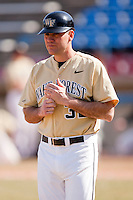 Wake Forest Demon Deacons head coach Tom Walter makes his way to the third base coaching box during a game against the Xavier Muskateers at Wake Forest Baseball Park March 7, 2010, in Winston-Salem, North Carolina.  Photo by Brian Westerholt / Four Seam Images