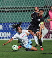 Chicago Red Stars midfielder Chioma Igwe (12) gets fouled by Washington Freedom forward Abby Wambach (20).  Washington Freedom tied with The Chicago Red Stars 0-0  at RFK Stadium, Saturday June 13, 2009.