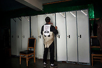 A researcher dresses in a panda costume in the changing rooms at the Hetaoping Panda Conservation Centre. The researchers wear the panda costumes to prevent the captive born pandas from becoming accustomed to humans.