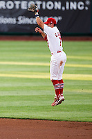 Greg Garcia (7) of the Springfield Cardinals makes a jumping catch on a hard hit ball towards center during a game against the Arkansas Travelers at Hammons Field on June 12, 2012 in Springfield, Missouri. (David Welker/Four Seam Images)