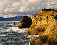Evening light on the cliffs above the Pacific Ocean; Cape Kiwanda State Park, OR