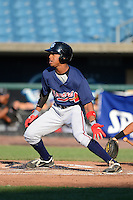 Outfielder Reese Cooley (12) of Fleming Island High School in Orange Park, Florida playing for the Atlanta Braves scout team during the East Coast Pro Showcase on August 1, 2013 at NBT Bank Stadium in Syracuse, New York.  (Mike Janes/Four Seam Images)