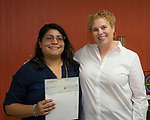 Lourdes Calzada-Santacruz, left, and Board Member Alexia Bratiotis Jobson during the Nevada Women's Fund Scholarship distribution, June 20, 2019.