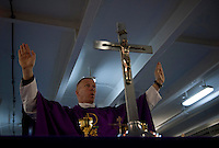 101205-N-7981E-148 PACIFIC OCEAN (Dec. 5, 2010)- Chaplain Cmdr. Keith Shuley, command chaplain of USS Carl Vinson (CVN 70), leads Roman Catholic mass on Vinson's foc'sle. Carl Vinson and Carrier Air Wing 17 are currently on a three-week composite training unit exercise (COMPTUEX) followed by a western Pacific deployment. (U.S. Navy photo by Mass Communication Specialist 2nd Class James R. Evans / RELEASED)