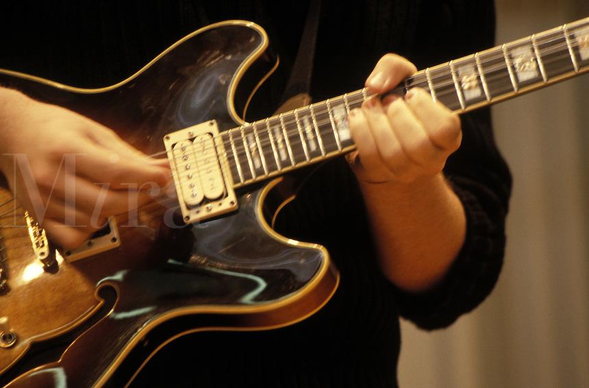 Closeup of man playing guitar. Guitar being played.