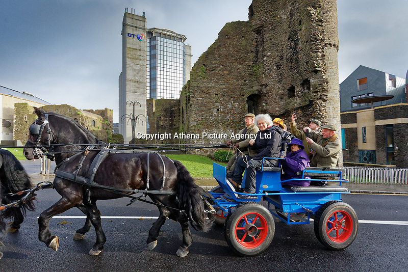 Pictured: Brian May on a horse cart travels past Swansea Castle. Thursday 26 December 2019<br /> Re: Guitarist Brian May of Queen has joined the Boxing Day Hunt in Wind Street, Swansea, Wales, UK.