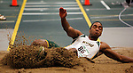 SPEARFISH, S.D. -- FEBRUARY 23, 2013 -- Jonathon Grace of Black Hills State soars in the triple jump Saturday during the 2013 RMAC Men's and Women's Track and Field Championships at the Donald Young Center on the campus of Black Hills State University.   (Photo by Richard Carlson/dakotapress.org)