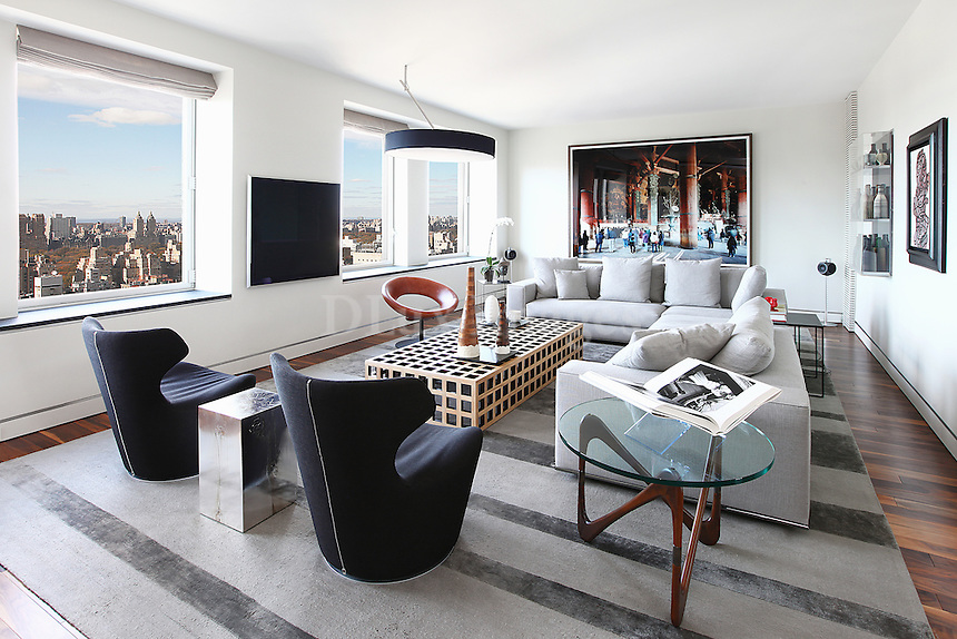 modern contemporary living room..This 3000 sq ft. apartment is located on the upper east side of Manhattan in New York.  It was completely gutted and re designed by Architect/Designer Christiana  Mascarenhas.  The apartment has 3 bedrooms and 4 bathrooms with amazing views from every room.