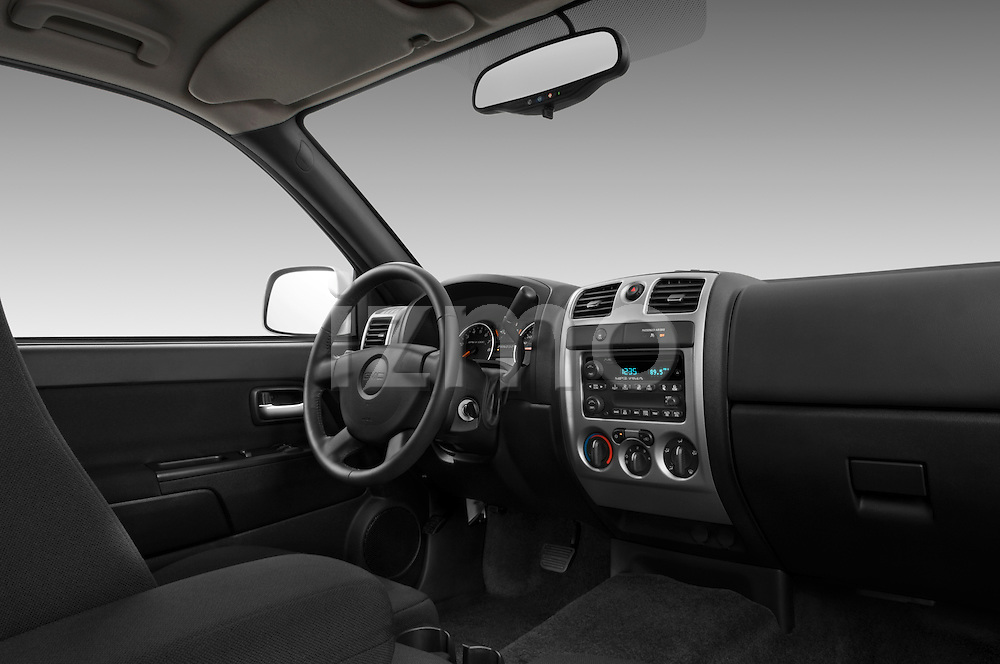 Low angle passenger side dashboard view of a 2009 GMC Canyon SLE Extended Cab.