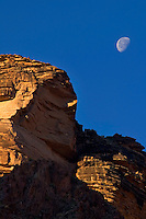The moon fades as daylight rises over the walls of the Grand Canyon along the Bright Angel Trail in Arizona.