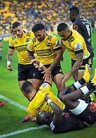 The Hurricanes celebrate Ben Lam's try during the Super Rugby match between the Hurricanes and Sharks at Sky Stadium in Wellington, New Zealand on Saturday, 15 February 2020. Photo: Dave Lintott / lintottphoto.co.nz