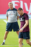 England manager Roy Hodgson and James Milner  during training
