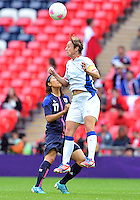 August 06, 2012..France's Sandrine Soubeyrand #6 and Japan's Yuki Ogimi #17 during Semi Final match at the Wembley Stadium on day ten in Wembley, England. Japan defeats France 2-1 to reach Women's Finals of the 2012 London Olympics.