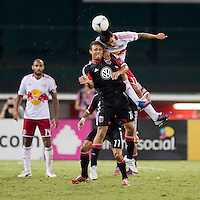 Nick DeLeon (18) of D.C. United goes up for a header with Tim Cahill (17) of the New York Red Bulls during the game at RFK Stadium in Washington, DC.  D.C. United tied the New York Red Bulls, 2-2.