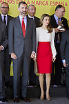 Spain's crown Prince Felipe and Princess Letizia pose with ambassador of the Brand Spain after a ceremony. February 12, 2013. (ALTERPHOTOS/Alvaro Hernandez)