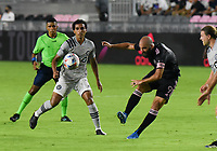 12th May 2021; Fort Lauderdale, Miami, USA;  Midfielder Ahmed Hamdi (7) of CF Montreal cannot stop the shot from Gonzalo Higuain of Inter Miami CF at the Inter Miami CF match against CF Montreal on May 12, 2021 at DRV PNK Stadium.