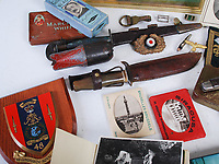 BNPS.co.uk (01202 558833)<br /> Pic: LindsayBurns/BNPS<br /> <br /> Pictured: Marine Jock Mathieson's  Fairbairn-Sykes fighting knife and another horn-handled knife.<br /> <br /> The medals, weapons and personal effects of a hero D-Day commando have sold for over £11,000 - 22 times their estimate.<br /> <br /> Marine Jock Mathieson narrowly escaped death during the Normandy landings on June 6, 1944.<br /> <br /> A bullet pierced the fuel tank of his motorbike which he was carrying above his head while wading through the sea towards Juno Beach.