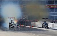 Apr. 28, 2013; Baytown, TX, USA: NHRA top fuel dragster driver Terry McMillen (left) races alongside David Grubnic during the Spring Nationals at Royal Purple Raceway. Mandatory Credit: Mark J. Rebilas-