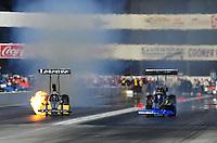 Nov. 11, 2011; Pomona, CA, USA; NHRA top fuel dragster driver Mike Ashley (left) explodes an engine alongside Pat Dakin during qualifying at the Auto Club Finals at Auto Club Raceway at Pomona. Mandatory Credit: Mark J. Rebilas-.