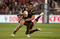 Anton Lienert-Brown is tackled during the 2021 Super Rugby Aotearoa final between the Crusaders and Chiefs at Orangetheory Stadium in Christchurch, New Zealand on Saturday, 8 May 2021. Photo: Joe Johnson / lintottphoto.co.nz