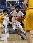 Bishop Gorman's Zaon Collins drives past a Bishop Manogue defender during the 4A NIAA state basketball championship game in Reno, Nev., on Friday, Feb. 23, 2018. Gorman won 62-41. Cathleen Allison/Las Vegas Review-Journal
