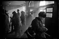 A Chinese man checks his train ticket at Changchun railway station in Changchun of Jilin province, China, 1985.
